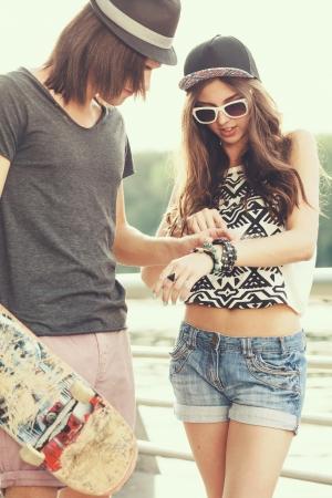 Girl shows boy her bracelets photo
