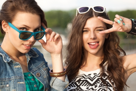 teenage love: Portrait of two young woman having fun. Outdoors, lifestyle