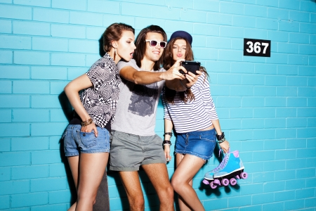 Two young girls ang guy having fun. Lifestyle Stock Photo