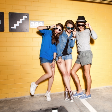 Two young girls ang guy having fun. Lifestyle Stock Photo - 21000469