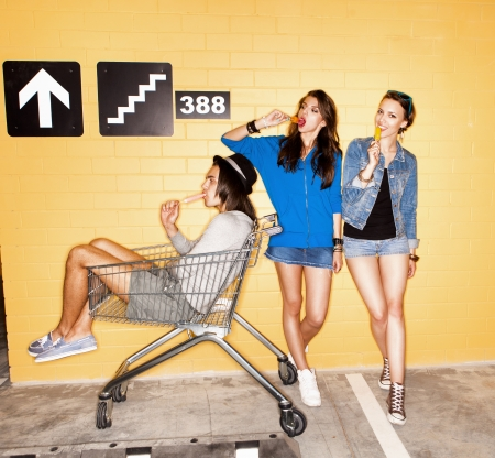 eating ice cream: Three young sensual people eating ice cream. Lifestyle, Stock Photo