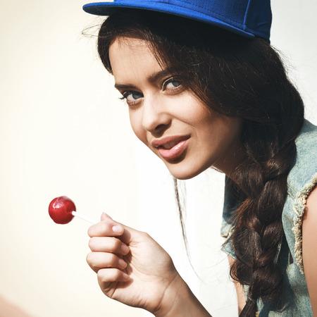 sucking lollipop: Young sensual girl sucking lollipop.