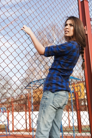 naughty woman: Portrait of a beautiful girl hipster. Trendy young naughty woman holding at the net. Outdoors, lifestyle.