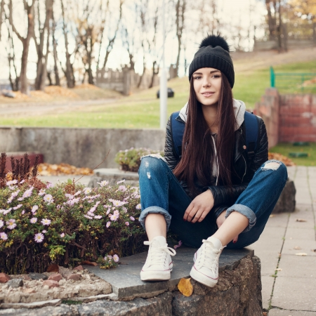 Portrait of a beautiful girl hipster.  Outdoors, lifestyle. photo