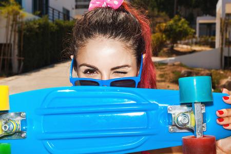 teen girl bikini: Funky girl in sunglasses with blue longboard. Lifestyle outdoor portrait.