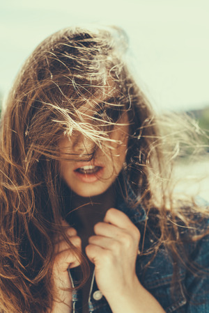 Close-up of hipster girl with windy hair Stock Photo