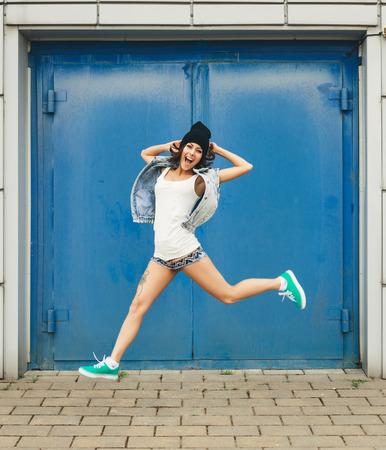 Funky teenage girl having fun  Lifestyle portrait photo