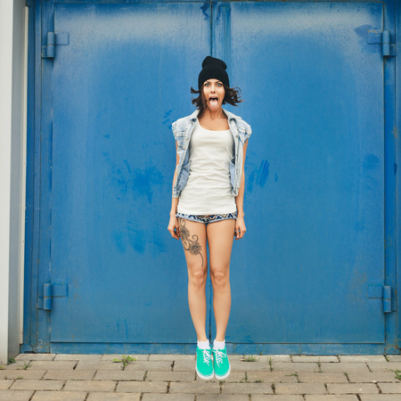Young funky woman jumping and having fun  Lifestyle portrait of girl photo