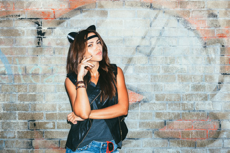 Bad girl  with leather cat ears. Urban scene. Outdoor lifestyle portrait Stock Photo