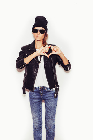Girl in sunglasses Forming a Heart with Her Hands.