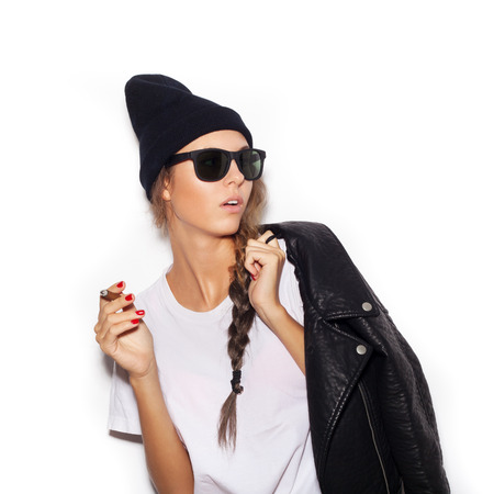 Hipster girl in sunglasses  smoking cigar.  photo