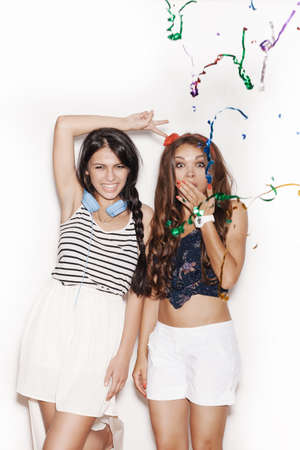 two women hugging: Pretty brunette girls with bright makeup having fun. Two sweet women laughing  on white background, not isolated Stock Photo