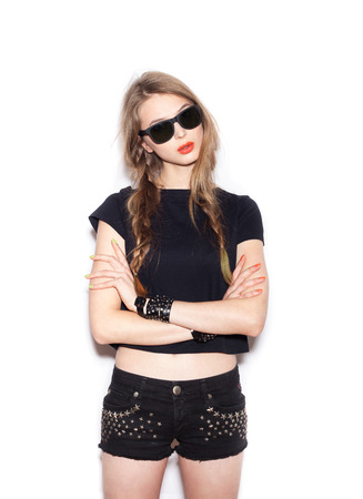 Fashion girl hipster with two long braids in sunglasses.  White background, not isolated