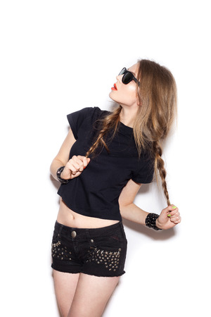 Fashion swag girl  with two long braids in sunglasses.  White background, not isolated