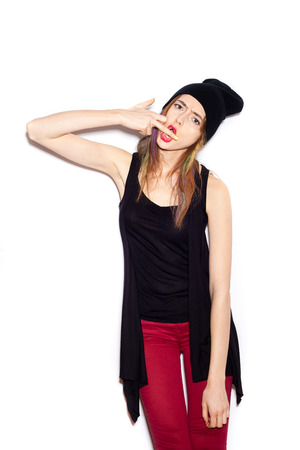 Young woman showing middle finger over white background, not isolated photo