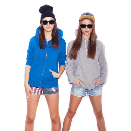 Swag girls standing together.  indoor portrait. White background not isolated photo