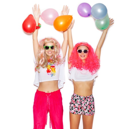 latex girl: Two girlfriends have fun with colored balloons. White background not isolated Stock Photo
