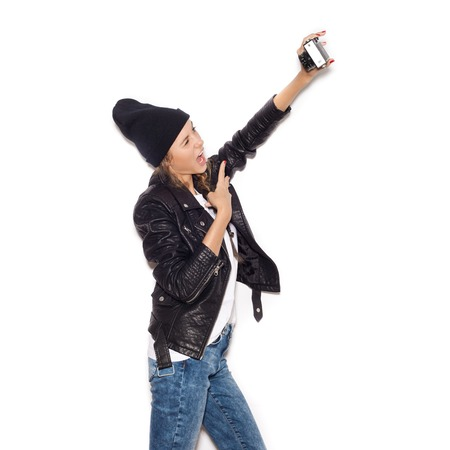 girl making selfie with noname vintage camera. White background, not isolated photo