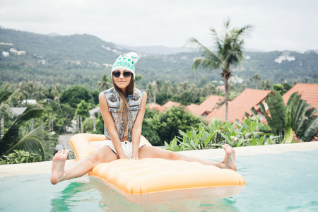 fresh face: Young pretty fashion sport woman posing outdoor in summer on tropic island in hot weather in bikini on pool party Stock Photo
