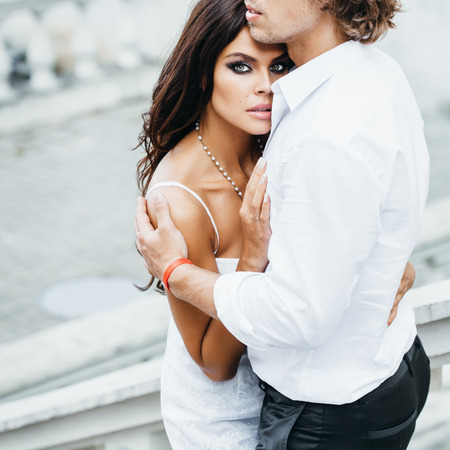 sexy wife: Young couple loving each other. Young man embracing a woman.