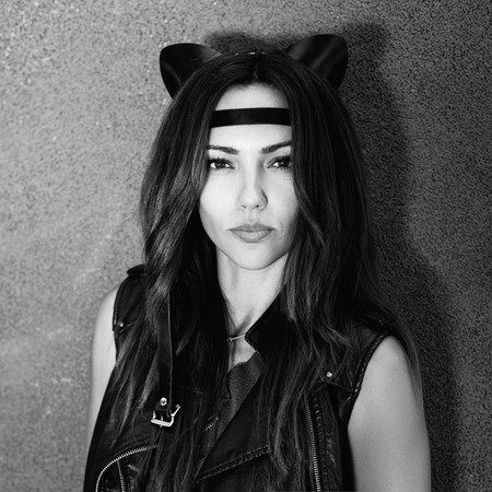 bad: Bad girl with leather cat ears. Urban scene. Outdoor lifestyle black white portrait