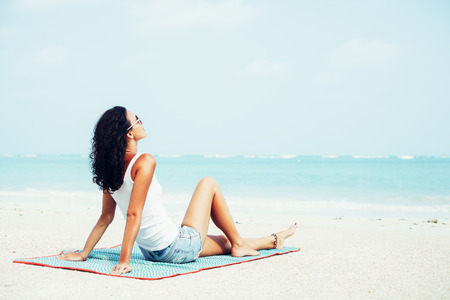 white sand: Young pretty woman relax on the beach. Outdoors lifestyle portrait Stock Photo