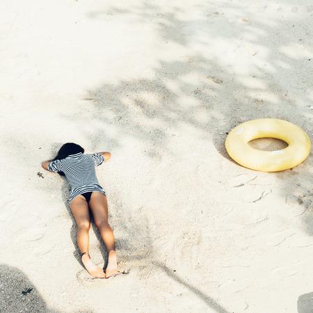 outdoor shot: attractive woman in bikini, outdoor shot in sand, summer day