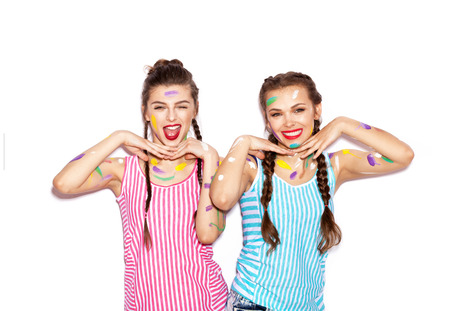 not painted: Two painted young girl friends having fun. Women face curve. White background not isolated