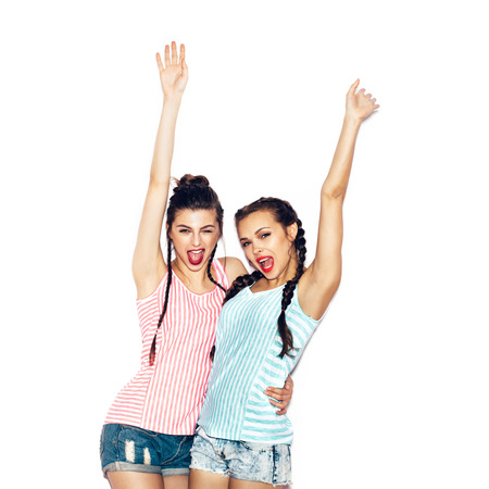 hug: Two fashion young girl friends hugging and having fun. White background not isolated Stock Photo