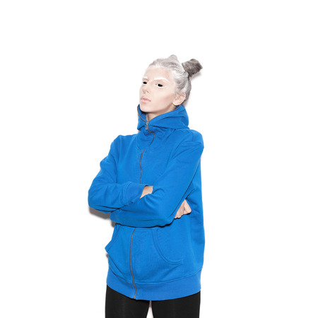 Scary evil young woman with black eyes for a fear or Halloween concept. Beauty girl with bright makeup hairstyle with horns in a blue hoodie having fun. Not isolated on a white background photo