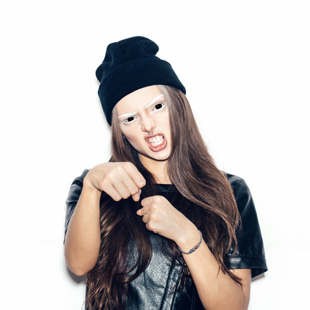 young teenage girl in black beanie for a fear or Halloween concept. White background not isolated photo