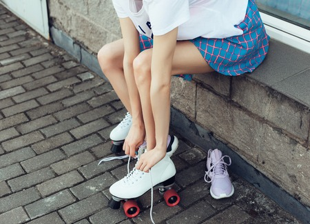 roller skate: Close-up Of Legs Wearing Roller Skating Shoe, Outdoors lifestyle portrait Stock Photo