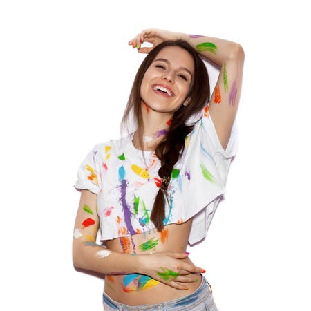 flirt: Young cheerful soiled in paint girl having fun