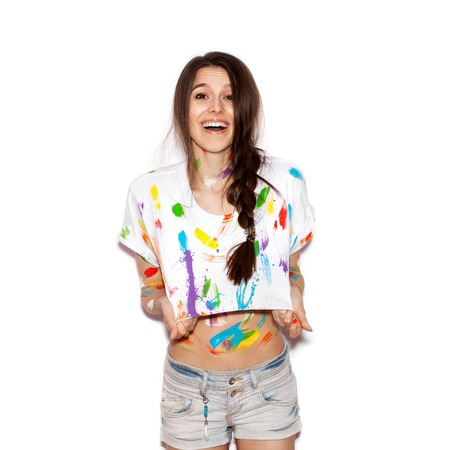 crazy girl: Young cheerful soiled in paint girl having fun