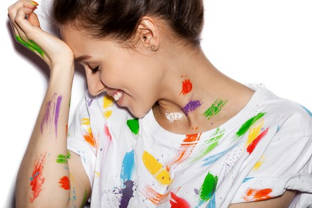 artist: Young cheerful soiled in paint girl having fun