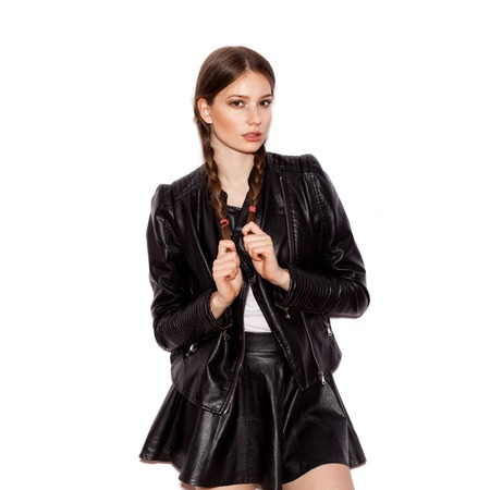 Woman with pigtails in black leather jacket. White background not isolated