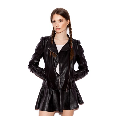 Woman with pigtails in black leather jacket. Girl  with sunglasses looking at the camera. White background not isolated