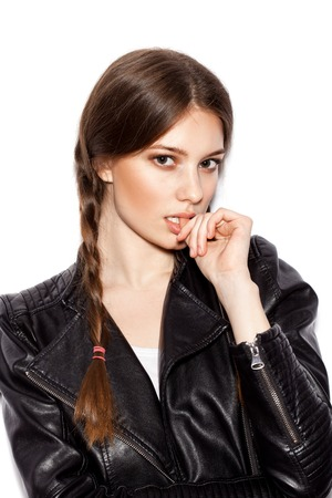 leather coat: Hair Braid. Beautiful Woman with Healthy Long Brown Hair. Hairdressing. Hairstyle. Beauty Glamour Fashion Model Girl Portrait. Perfect Skin and Makeup Holiday Make up.