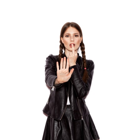 naughty woman: Fashion girl hipster. Young woman showing stop gesture. White background not isolated Stock Photo