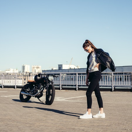 black lady: Sexy Woman near old fashioned custom motorcycle. Outdoor lifestyle portrait