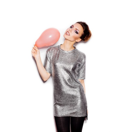 silver dress: Fashoin cute woman wearing silver dress and holding pink balloon on white background not isolated Stock Photo