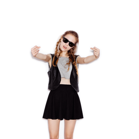 showing: Teen Girl in sunglasses showing middle fingers. Young woman having fun. Not isolated on white background