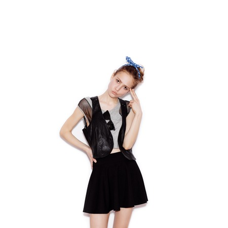 swag: Fashion swag young woman gun showing. Girl having fun. White background, not isolated