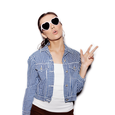 vogue style: Girl in a sunglasses having fun on a white background not isolated