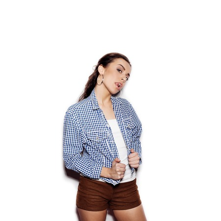 isolated woman: Pretty woman in a blue plaid shirt flirting and licks tongue lips on a white background not isolated Stock Photo
