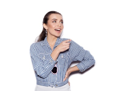 blue plaid: Happy smiling girl in a blue plaid shirt on a white background not isolated Stock Photo