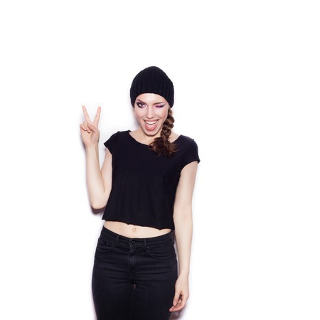 Sexy woman in black clothes having fun. Portrait of expressive girl on white background not isolated photo