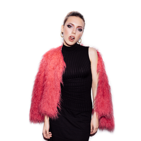 pink fur: Fashion Beauty Girl wearing black dress and pink fur coat. Gorgeous young Woman Portrait. Stylish Haircut and Makeup. Vogue style studio shot on white background not isolated