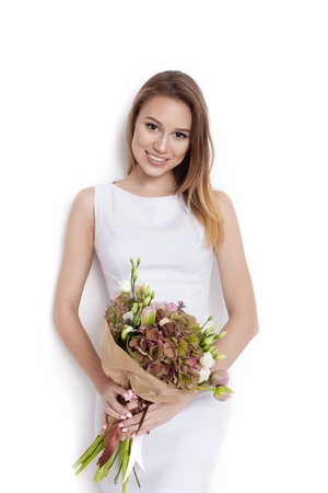 fashion and beauty: Beauty Fashion Model Woman with big Bouquet of flowers. Portrait with the Bunch of Red Rose flowers. Red Lips. Beautiful Brunette Girl with Luxury Makeup, perfect skin. Not isolated on white background