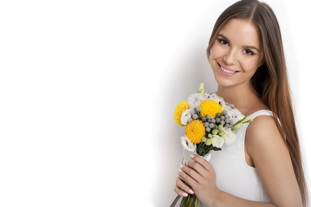 sexy wife: Woman with Spring Flower bouquet  while standing against white background not isolated. Mothers Day. Springtime